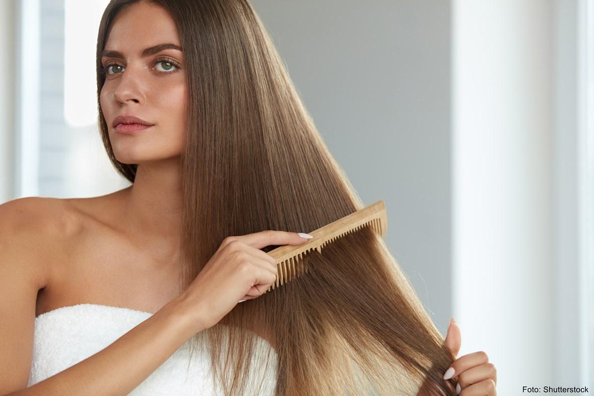 Woman-brushing-hair